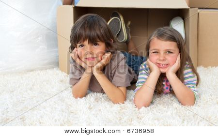 Cute Siblings Playing With Boxes
