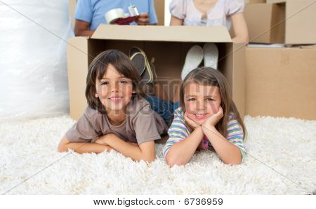 Adorable Siblings Playing With Boxes