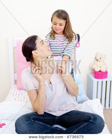 Adorable Little Girl Cuddling Her Mother