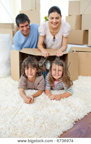 Jolly Family Playing With Boxes