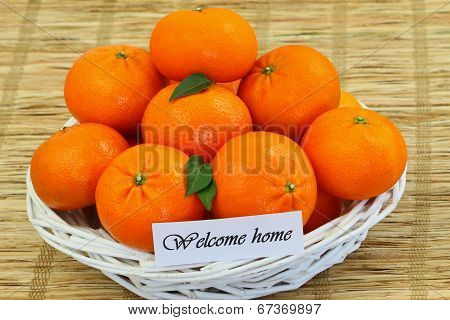 Welcome home card with basket full of mandarines