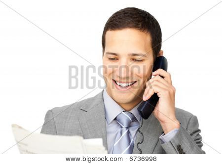 Charsmatic Businessman On Phone Holding A Newspaper