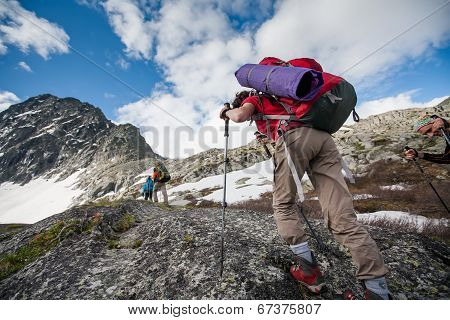 Hikers Are Climbing Rocky Slope Of Mountain In Altai Mountains, Russia