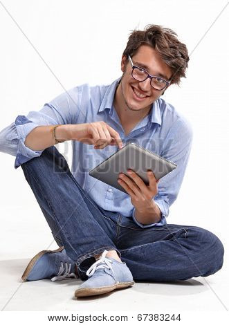 Young businessman using a tablet computer - isolated over a white background