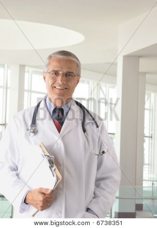 Middle Aged Doctor In Modern Medical Facility