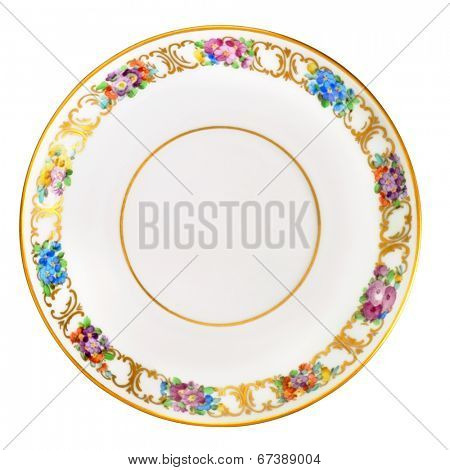 Antique over hundred years old german small porcelain saucer plate. Floral ornament with gold plated lines and circles. Isolated with path on white.