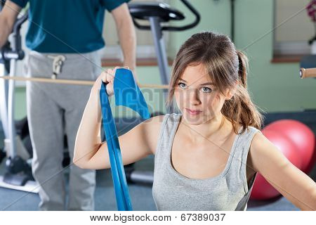 Girl Exercising At Physiotherapy Clinic