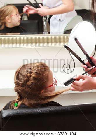 In Hair Salon. Little Girl Child Sitting By Hairdresser Combing Hair