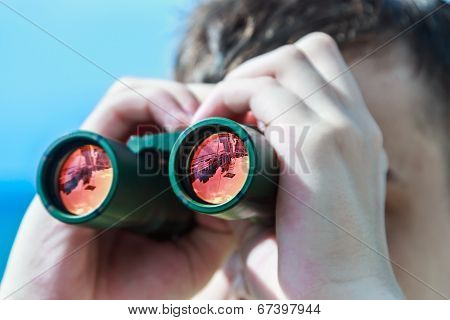 Man Is Looking To The Binocular On Sea