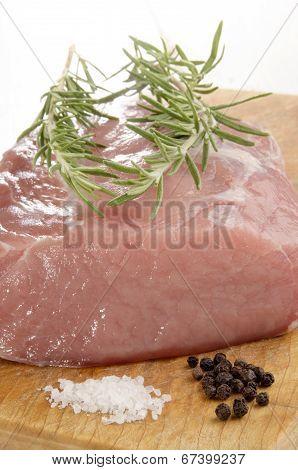 Raw Pork Loin On A Wooden Board