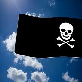 stock photo of skull crossbones flag  - Pirate Black Flag with white Skull and Crossbones sign on blue sky background - JPG