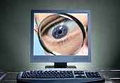 foto of maliciousness  - Eye with magnifier on a computer screen as an icon for monitoring - JPG