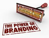 stock photo of loyalty  - The Power of Branding words and a brand iron to illustrate trust - JPG
