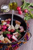 pic of vedic  - cooked roasted radishes lying in the form of heat - JPG