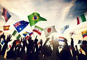 stock photo of waving  - Group of People Waving Flags in World Cup Theme - JPG