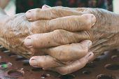 foto of middle finger  - Selective focus in the middle of female old hands - JPG