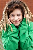 stock photo of dreads  - Young happy rasta girl with dreads smiling - JPG