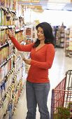 foto of supermarket  - Woman shopping in supermarket - JPG