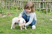 image of piglet  - White piglet in girls hands smiling - JPG