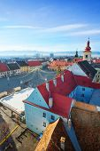 stock photo of sibiu  - Rows of red roofs near Piata Mare  - JPG