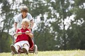 image of karts  - Young boys playing with go - JPG