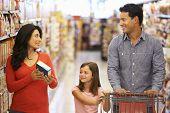 foto of supermarket  - Family shopping in supermarket - JPG