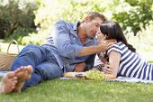 stock photo of recliner  - Couple on romantic picnic - JPG