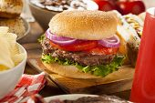 stock photo of hamburger  - Hearty Grilled Hamburger with Lettuce and Tomato on a Bun - JPG
