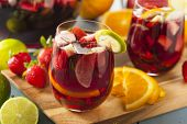 foto of sangria  - Homemade Delicious Red Sangria with Limes Oranges and Apples - JPG
