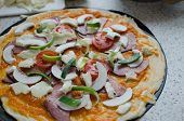 image of doma  - Home made pizza with pork tomato salami and soda - JPG