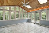 stock photo of screen-porch  - Sunroom in suburban home with wall of windows - JPG