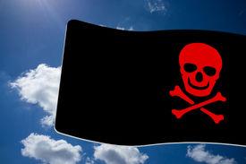 foto of skull crossbones flag  - Pirate Black Flag with red Skull and Crossbones sign on blue sky background - JPG