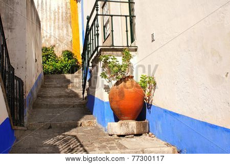 Narrow street in Obidos, Portugal