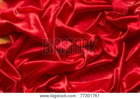 Luxurious deep red satin/silk folded fabric. Art background