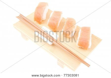 Nigiri Sushi - Set of Nigiri sushi topped with raw Salmon . isolated over white background . on wooden board