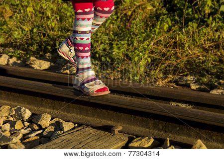 Little Girl On Rail