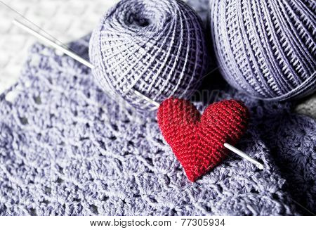 Threads with red handmade knitted  heart