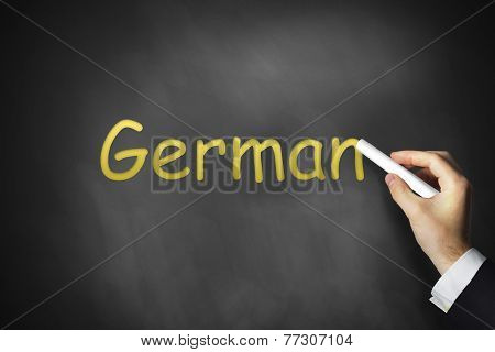 Hand Writing German On Chalkboard