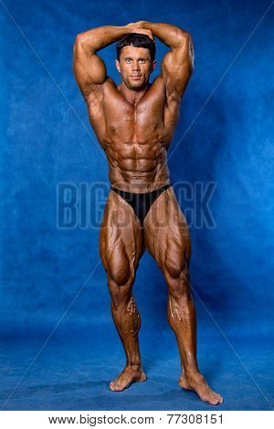 Athletic Sports Bodybuilder Demonstrates Posture