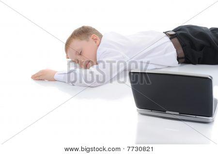 Little Boy Fell Asleep In Front Of A Laptop