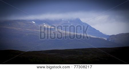 Mountain in overcast weather in distance.