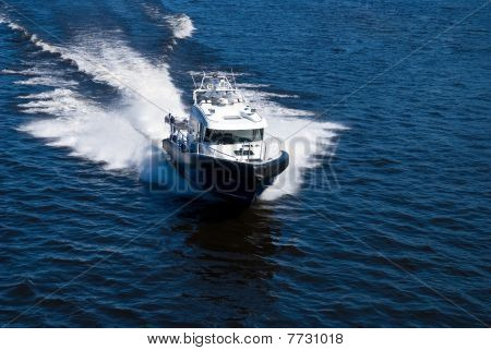 Speeding Power Boat