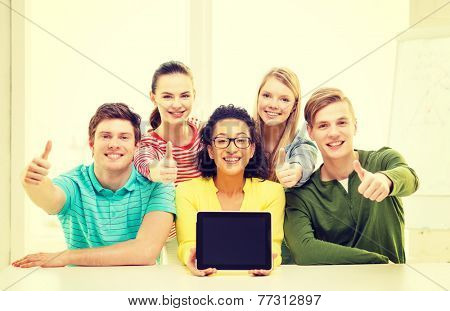 education, technology and college concept - five smiling students with tablet pc computer blank screen at school showing thumbs up
