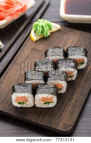 Sushi rolls with salmon and scallion