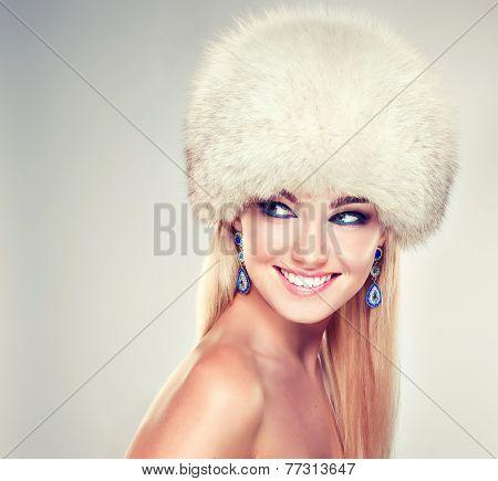 Beautiful winter girl in a fur hat