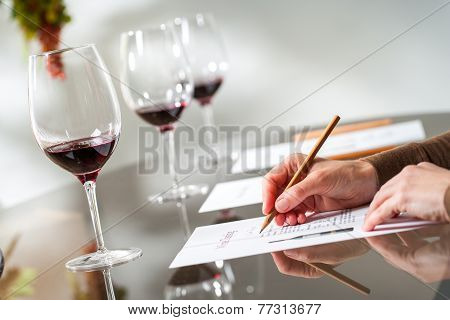 Hands Taking Notes At Wine Tasting.