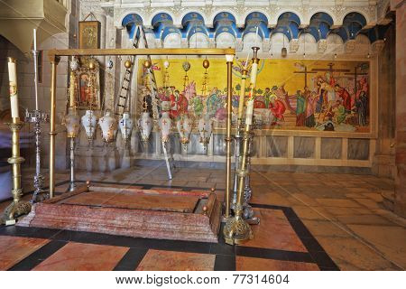JERUSALEM, ISRAEL - MARCH 9, 2012: The oldest Christian sanctuary - Stone of Unction in the Temple of the Holy Sepulcher