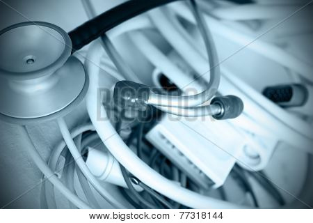 Symbols Of Medicine Stethoscope Against A Set Of Ecg Leads