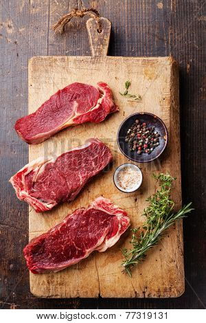 Raw Fresh Meat Ribeye Steak Entrecote And Seasoning On Dark Wooden Background
