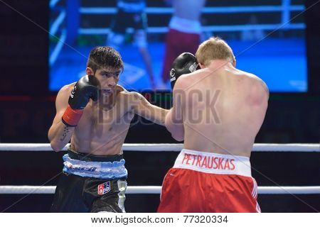 NOVOSIBIRSK, RUSSIA - NOVEMBER 29, 2014: Match Evaldas Petrauskas of Lietuva (right) vs Carlos Aquino of Argentina during AIBA Pro Boxing tournament. The winners will go to the Olympics-2016